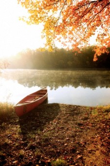 Canoe by lake in autumn